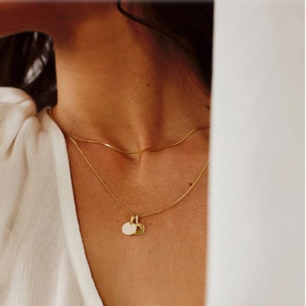 Flawed ivory charm gold